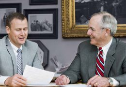 Mike Hall Sr. & Mike Hall, III discussing a personal injury case