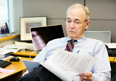 MN Personal Injury Lawyer Reading Case Documents