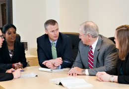 Hall Law team in personal injury case meeting