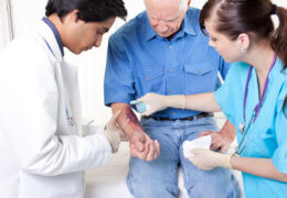 Doctor treating burn, Hall Law personal injury lawyers