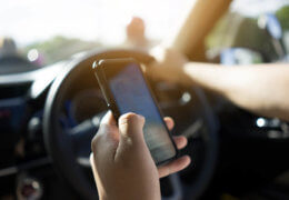 Driver uses smartphone while driving
